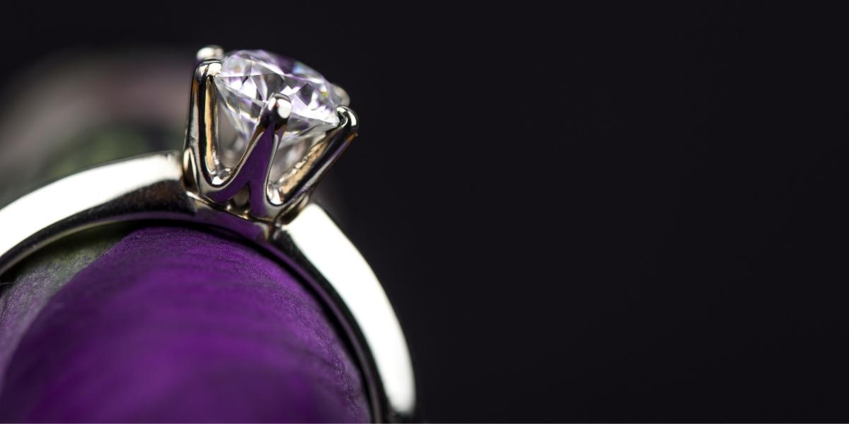 A broken or chipped diamond solitaire in an engagement ring setting