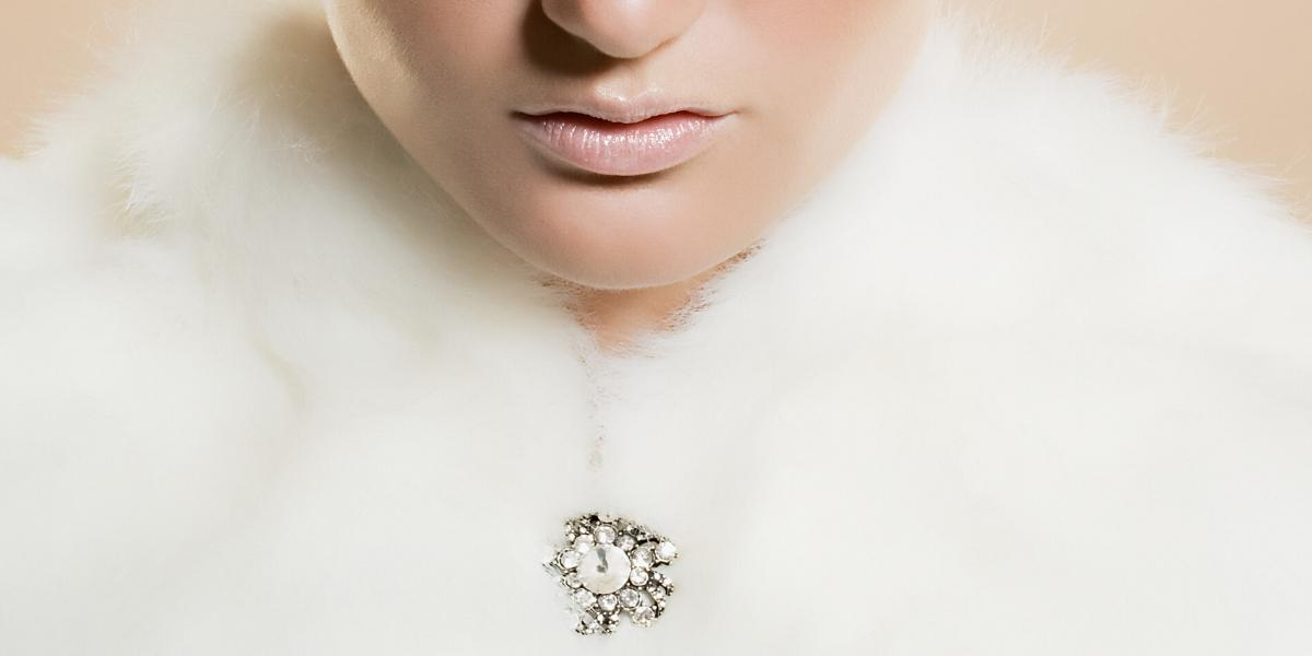 A diamond brooch holding a jacket closed, illustrating how to wear a brooch pin for modern style