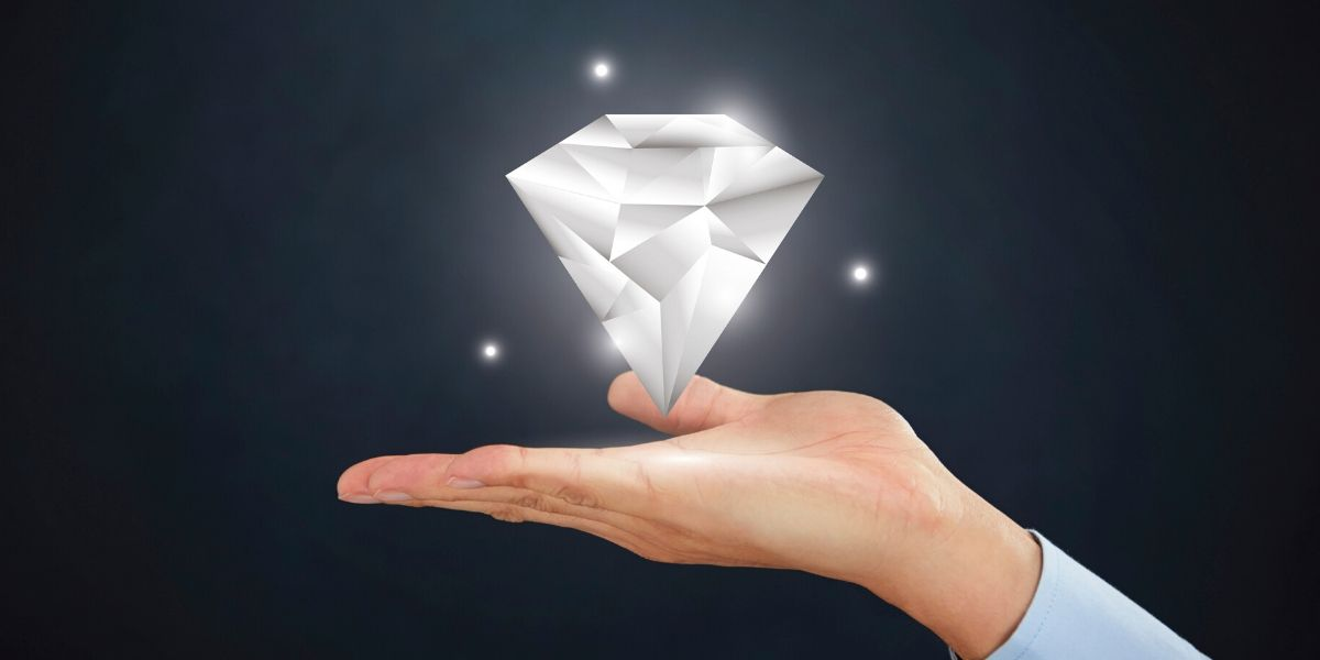 A diamond hologram floating above the open palm of an outstretched hand