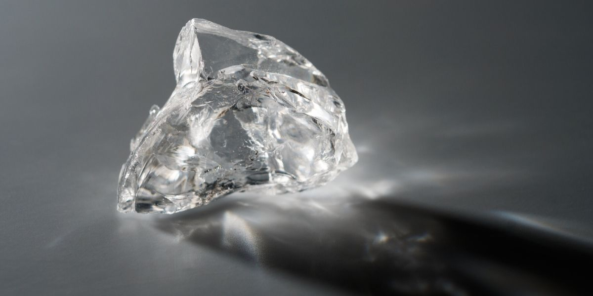 A rough diamond awaiting cutting