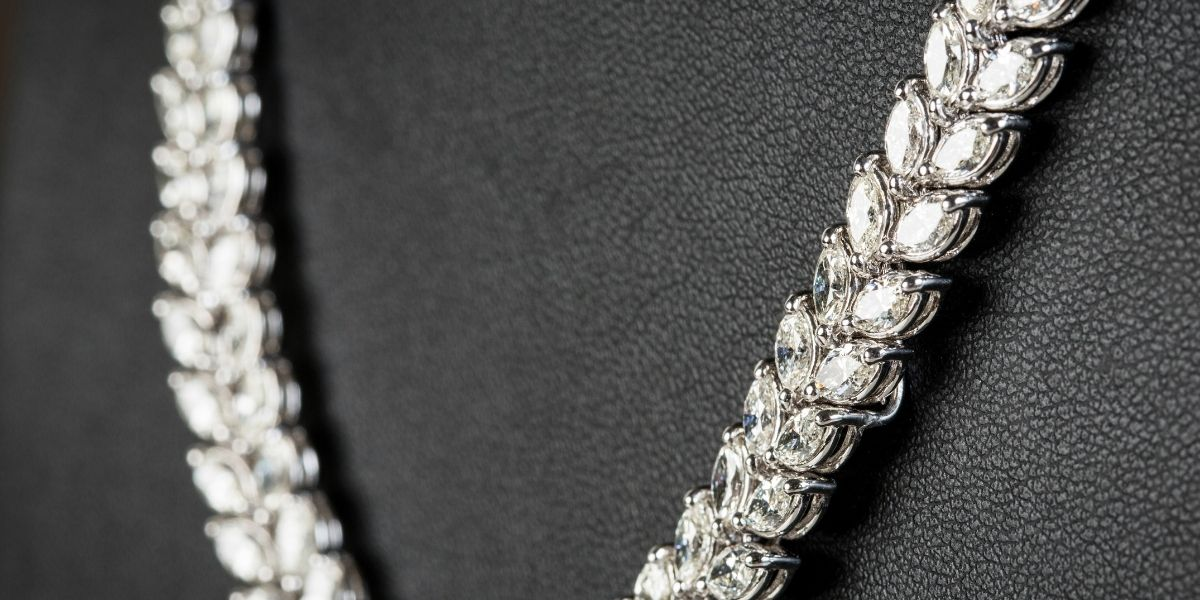 A large chunky chain covered in diamonds - one of the top women's fine jewelry trends for 2021